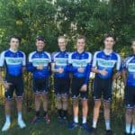 Star cyclists Balmoral Elite Team stand in front of a hedge with their thumbs up