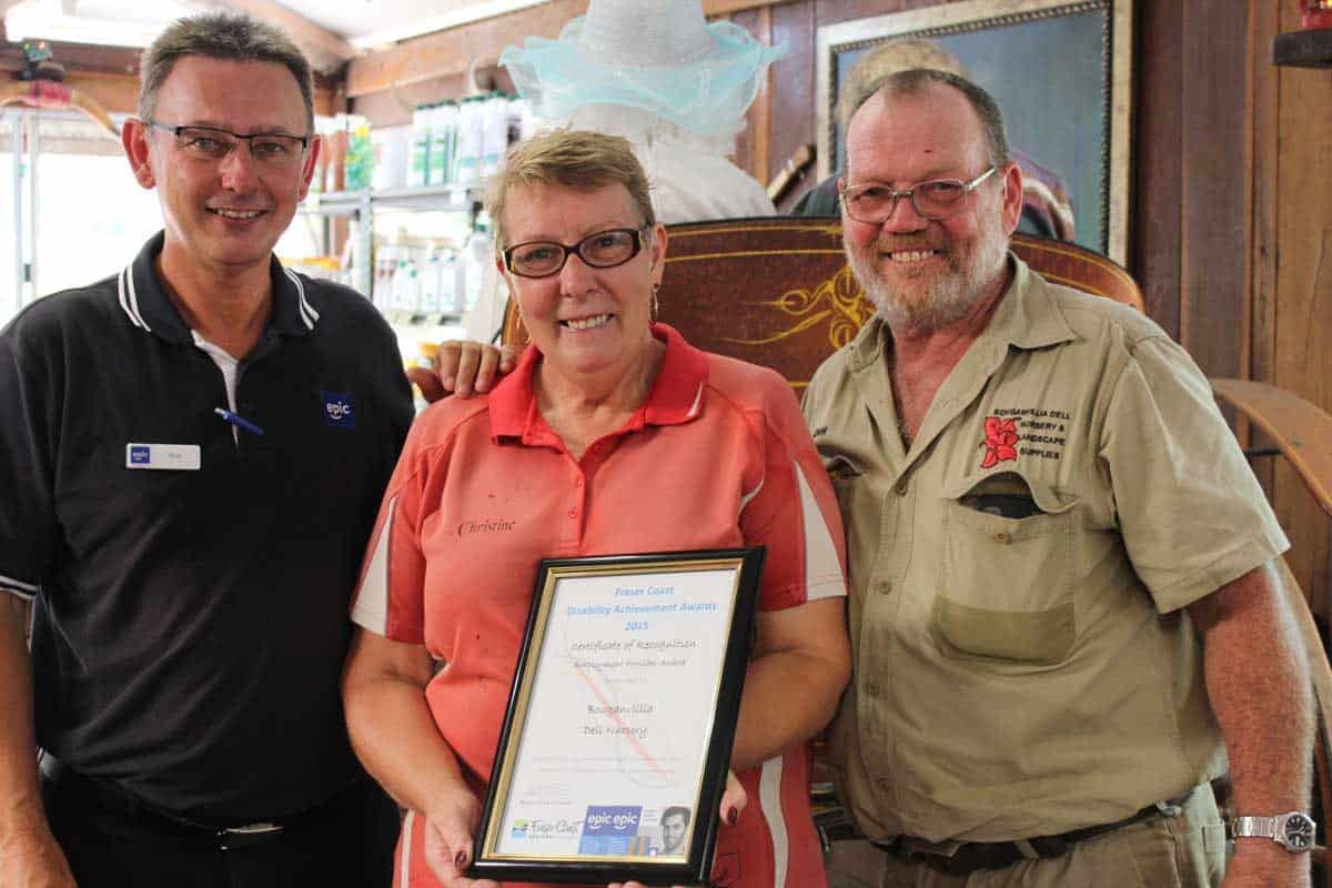 From left EPIC Employment Consultant Chris, with Christine and Don holding their award