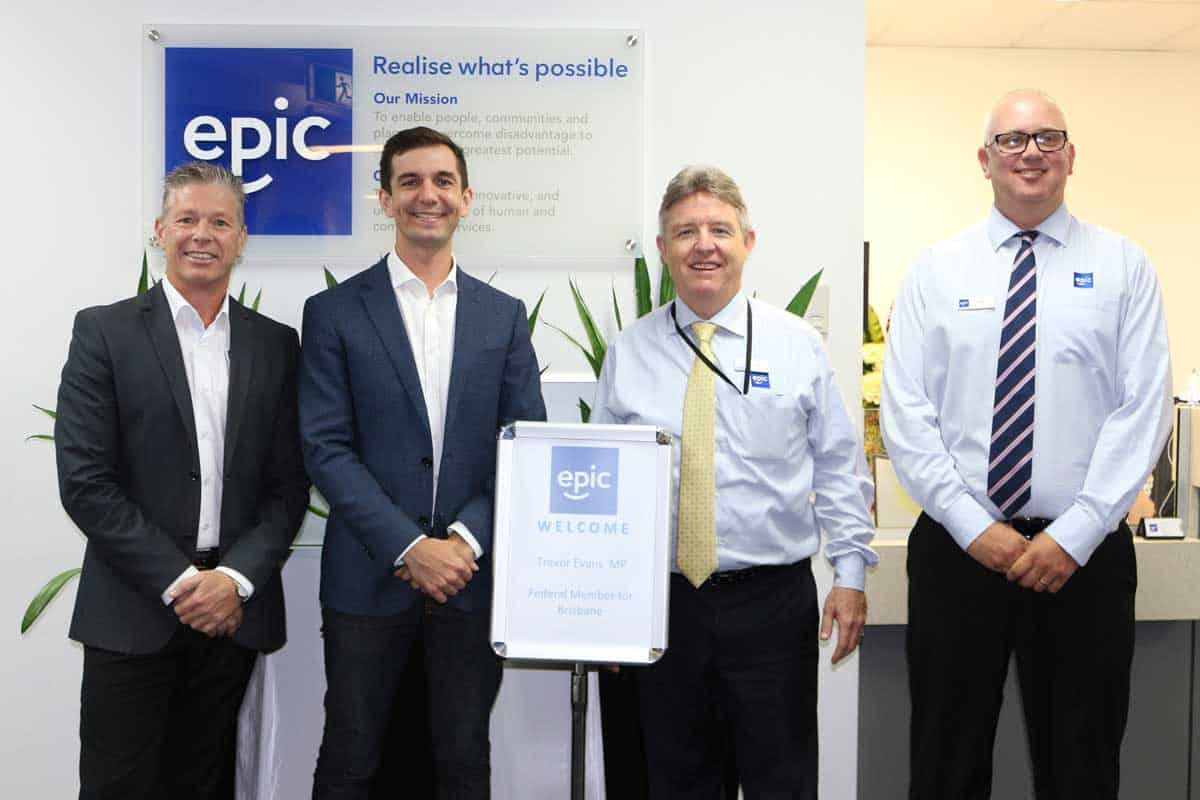 Mr Trevor Evans MP (second from left) with EPIC Assist's Nigel Hendy, Bill Gamack and Dean Graham standing in the foyer of EPICs Head Office