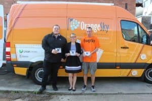 EPIC Business Development Manager Joel Power presents Orange Sky's Emma Young & Neville Owen with toiletry packs for their friends on the street