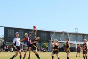 The North Lakes Eel Junior AFL Football team playing a game of football