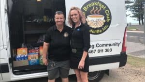 EPIC Assist's Tammy Lee with The Breakfast Clubs founder, standing in front of The Breakfast Club van