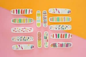 Illustrated band aids sit on a colored background