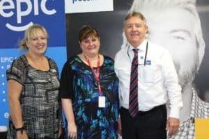 EPIC Training Manager Prudence Bessant, mh@work Founder and Managing Director Ingrid Ozols and EPIC CEO Bill Gamack, stand in the EPIC Assist Head Office