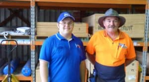 Paul with his employer in the Mitre 10 timber section