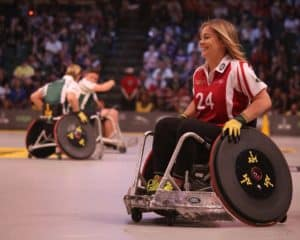 A woman playing a game of wheelchair basketball