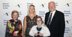 Ella Cassidy and Natasha Caflisch with officials at the National Disability Awards in Canberra