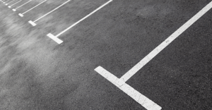 A close up of a parking space in a parking lot