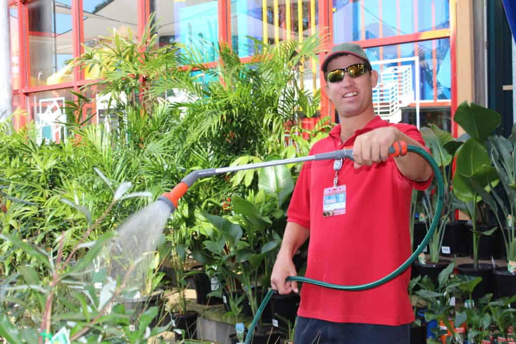 EPIC job seeker Mark hosing plants in the garden centre at Bunnings