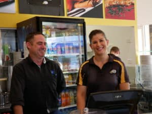 Emma, owner of Crepe Cafe Aspley and Andrew business development manager at Epic Assist smile at the camera