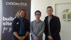 Shen stands with his manager and EPIC Consultant Lisa at his workplace, Chromatix