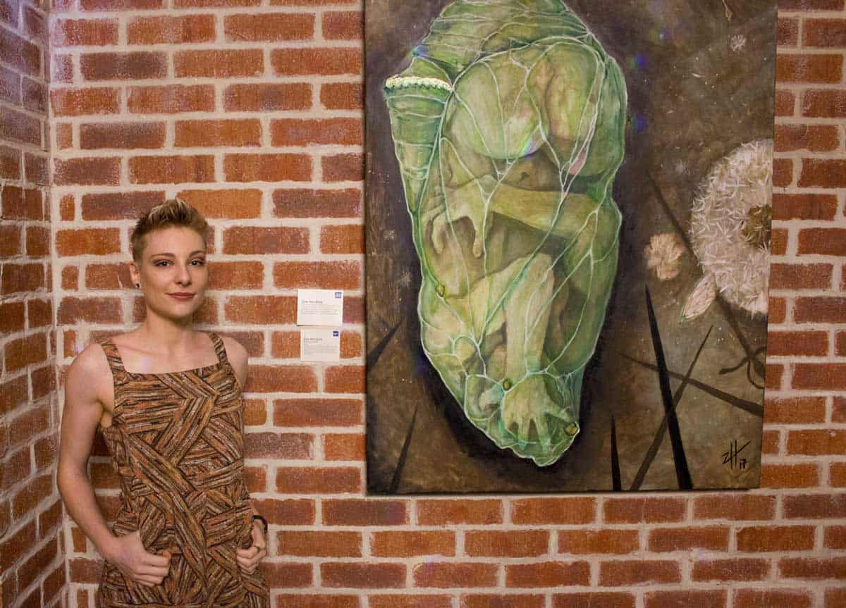 Zoe Hankins stands in front of her artwork ''Eight of Swords' at EPIC's Seen and Unseen art exhibition