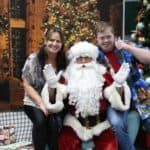 EPIC staff member Joellen and EPIC participant Jarrod with Santa at the 2018 Participant Christmas Party
