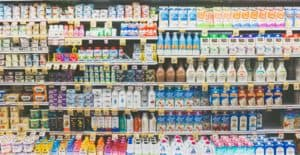 A photo of a large grocery store dairy shelf.