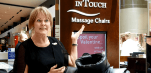 April stands in front of the InTouch Massage Chairs shop