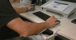 An ergonomic wrist support supports Paul's left hand.