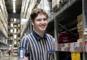 EPIC retail student, Brayden, stands amongst the shelves at IKEA