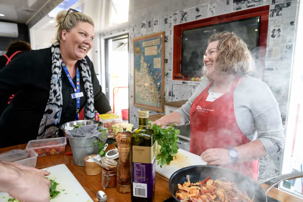 EPIC job seekers smiles as she chops up food