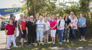 A group of volunteers for the Logan East Community Neighbourhood Association stand outside