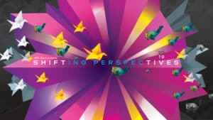 A pink and black banner with the words 'Shfiting Perspectives' written across it