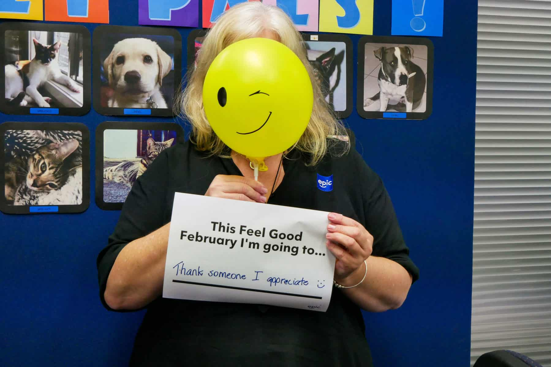 """EPIC staff member Mandy holds her Feel Good February message: """"thank someone I appreciate."""""""